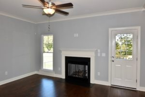 Fireplace and back door at 3268 Farm Bell.